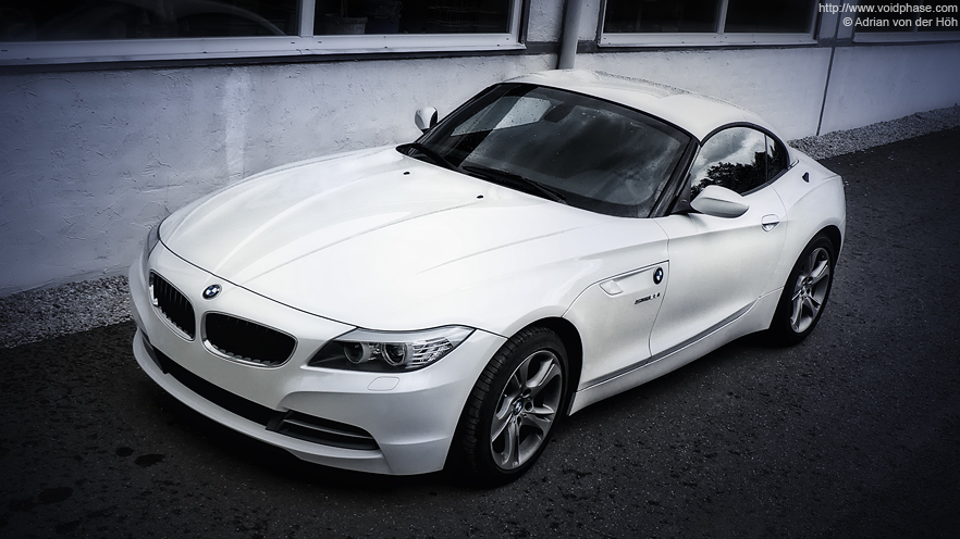 white BMW Z4 Roadster (23i)