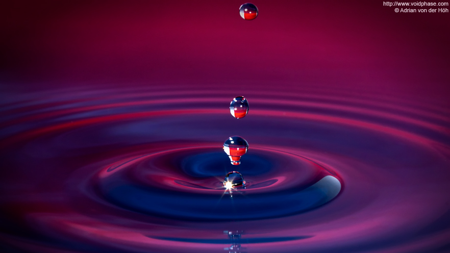 water drop hits surface of liquid, jet of water is collapsing (purple)