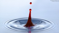 Photo of red jet generated by water droplet