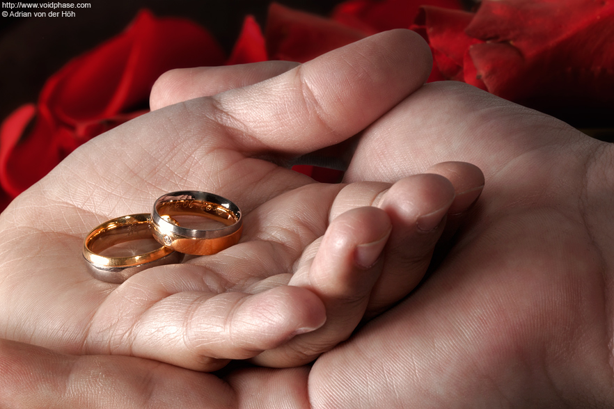 Wedding/Marriage: Hand in Hand with golden Rings