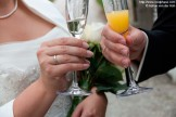 Bride and Groom toasting with glasses (close-up)